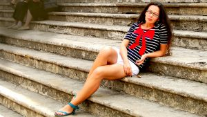 girl laying on stone stairs in Italy resting