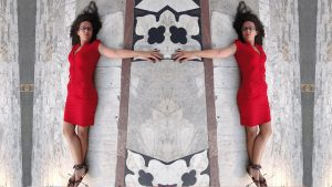 double woman red dress lying on marble