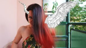 red head woman with red hair with wings and horns angel and demon