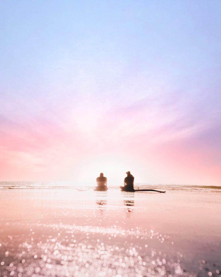 peaceful beach pastel colors two people sea ocean quite solitude