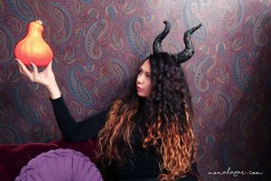 halloween curly girl holding pumpkin to be or not to be moody dark interior maleficent horns halloween costume