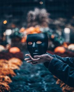 halloween dark black mask male hands orange