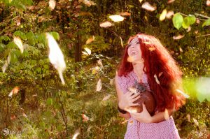 redhead girl laughing forest autumn fall lantern sepia happiness